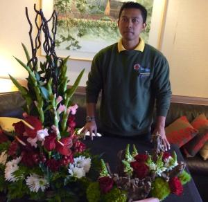 MS Veendam's head floral designer Agus, prepares two elegant floral displays.
