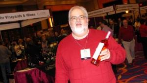 Howard Steven Frydman displays a bottle of Rose wine.