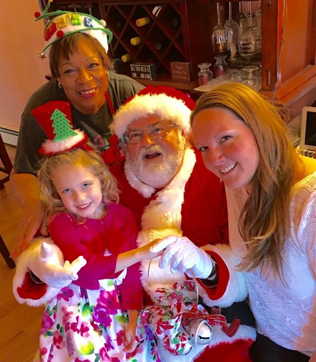 "Howard Steven Frydman aka ""Santa Howard"" visits with Lucy Hurston and her family"